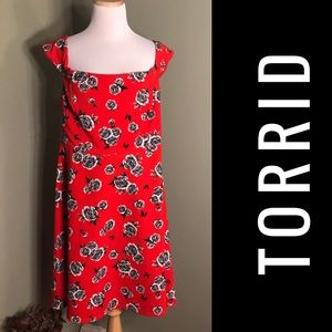 Torrid 3 Dress. Red background with flowers.